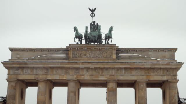 ms quadriga on top of brandenburg gate in winter / berlin, germany - east berlin stock videos and b-roll footage