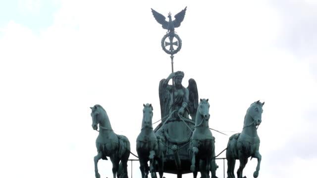 Quadriga statue on the Brandenburg gate on May 07 2019 in Berlin Germany