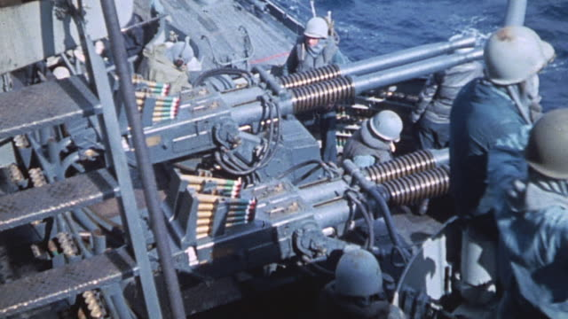 quadrupel mount 40mm gun and main batteries of uss nevada firing during world war ii / iwo jima japan - militärschiff stock-videos und b-roll-filmmaterial