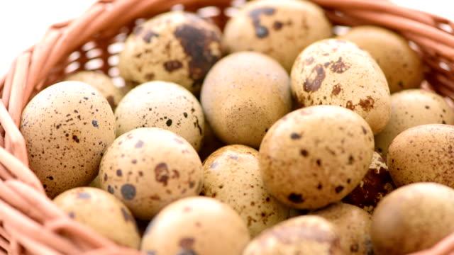 Quail eggs in wicker basket