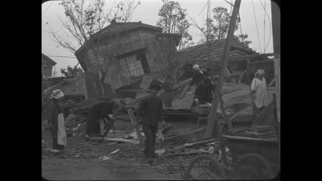 quake razes 5000 homes in japanizu peninsula japanpictorial scenes of the devastated area of japan where earthquake killed 250 and injured 1000 /... - 1930 stock-videos und b-roll-filmmaterial