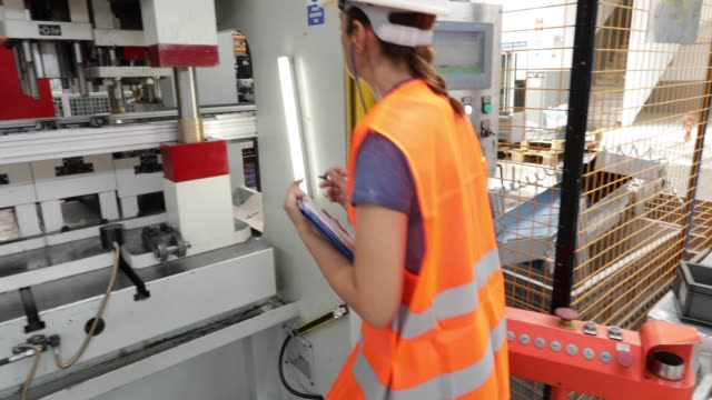 quality control supervisor checking production machines - manufacturing machinery stock videos & royalty-free footage