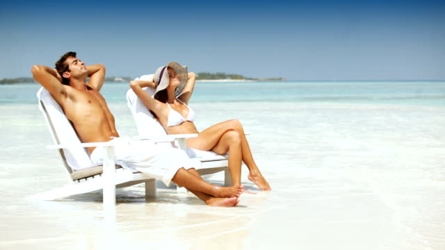 quality time together in paradise - deck chair stock videos & royalty-free footage