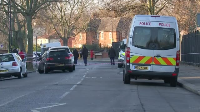 Funeral held after fundraising campaign T24011719 / TX London Willesden Police officers searching scene behind police cordon tape Police van and...