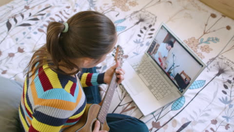 covid-19 quarantine. friends playing music together through a video call on the internet. music band repetition online. having fun while staying at home. - singing stock videos & royalty-free footage