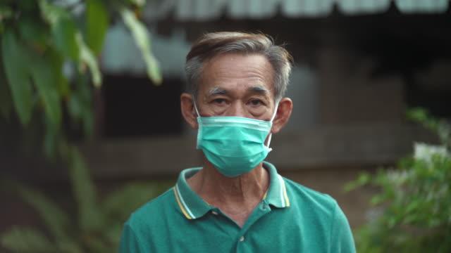 quarantine : lonely senior man - asian man coughing stock videos & royalty-free footage
