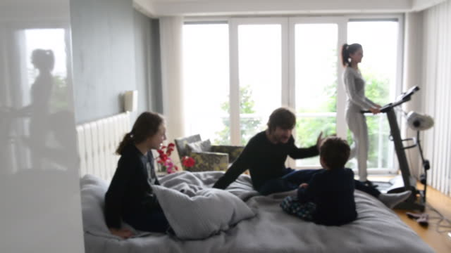 quarantined family at bedroom in the morning. defocused. - middle eastern culture stock videos & royalty-free footage