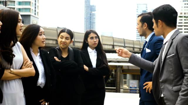 Quarrel between businesswomen and businessmen