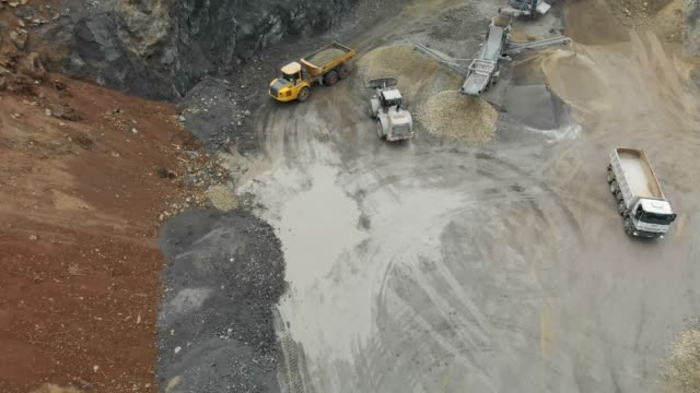 quarry mine industry - aerial view - earth mover stock videos & royalty-free footage