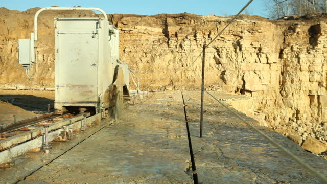 quarry saw cutting limestone rock - marble rock stock videos and b-roll footage
