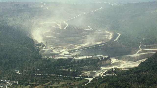 aerial ws quarry through clouds of dust / coimbra, portugal - quarry stock videos and b-roll footage