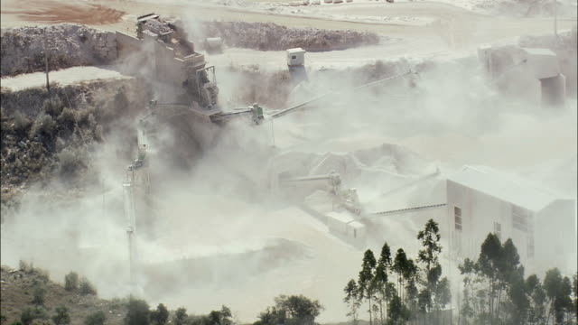 AERIAL WS Quarry through clouds of dust / Coimbra, Portugal