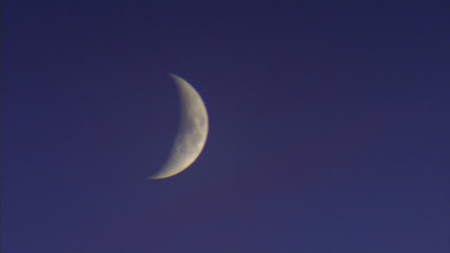 quarter moon in blue sky w/ no clouds phases - quarter stock-videos und b-roll-filmmaterial