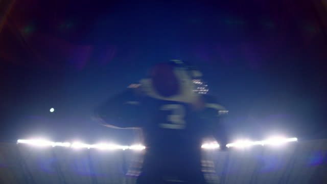 ms la quarterback dropping back and throwing pass during football game at night in stadium - one mid adult man only stock videos & royalty-free footage