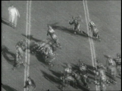a quarterback hands off the ball to a teammate who runs to make a touchdown for notre dame university - american football ball stock videos & royalty-free footage