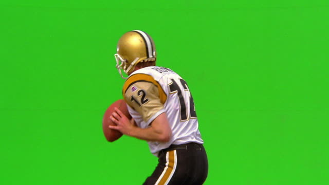 chroma key quarterback throwing football + punching fist in air / green background - throwing stock videos & royalty-free footage