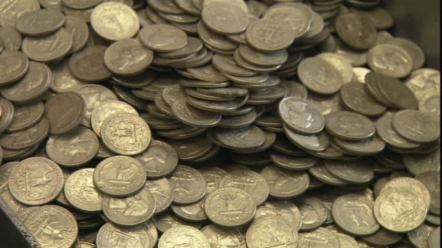 u.s. quarters fall into a coin counting machine. - us coin stock videos & royalty-free footage