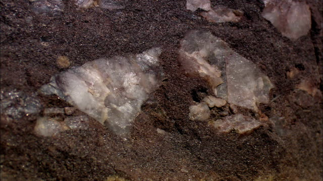 quartz and other silicates sparkle on a rock outcropping. - quartz stock videos & royalty-free footage