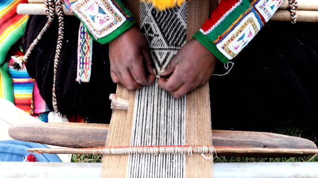 a quechua women weaves on may 23 2018 in tinki peru many quechua families especially women in high altitude isolated communities have little or no... - peruvian ethnicity stock videos & royalty-free footage