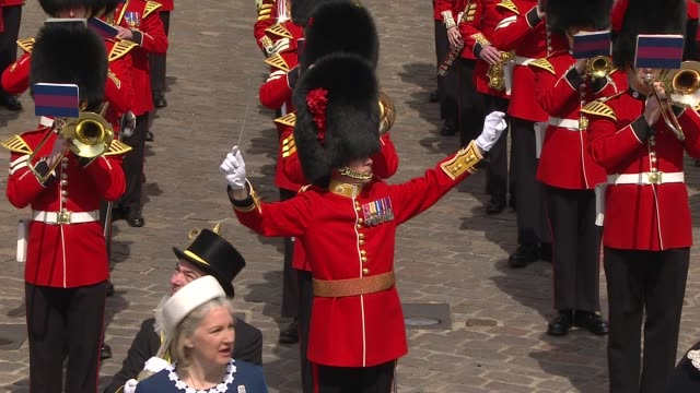Queen 90th Windsor Queen walkabout from1200pm Band plays national anthem / Motorcade carrying Queen Elizabeth II arrives in car in front of castle...
