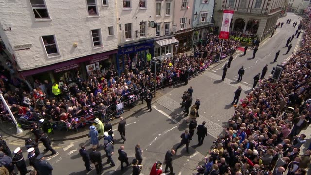 Queen 90th Windsor Queen walkabout from1200pm Queen Elizabeth II and Prince Philip shaking hands with officials / Queen along receiving cards and...