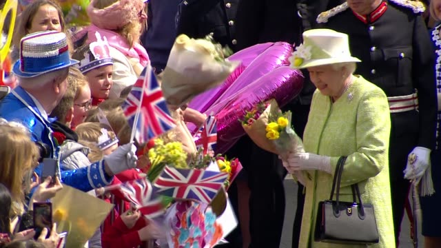queen 90th windsor queen walkabout from1200pm queen elizabeth ii past group of school children singing happy birthday / queen along receiving more... - 90th birthday stock videos and b-roll footage
