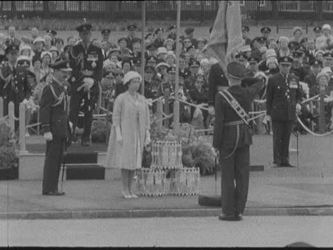 queen and duke at raf cranwell; england: lincolnshire: raf cranwell: ext lms queen to dais with officer bv party pan planes over - vampires and... - cadet stock videos & royalty-free footage