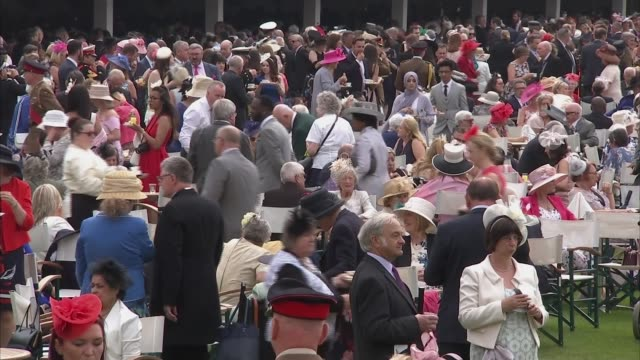 Queen and Duke of Cambridge host Buckingham Palace garden party ENGLAND London Buckingham Palace EXT GVs guests mingling in Buckingham Palace grounds...