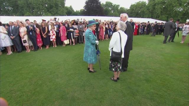 Queen and Duke of Cambridge host Buckingham Palace garden party ENGLAND London Buckingham Palace GVs Queen Elizabeth II along meeting various people