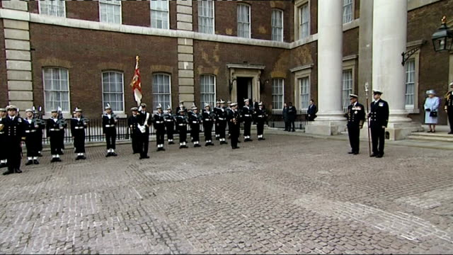 queen and duke of edinburgh at admiralty arch ext queen and prince philip on steps / prince philip walking forward as the guard of honour perform... - guard of honour stock videos and b-roll footage