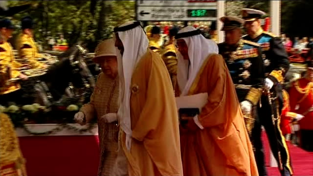 Queen and Duke of Edinburgh meet UAE President at Windsor Convoy of cars pulls up / Sheikh Khalifa bin Zayed Al Nahyan out shakes hands with Queen...