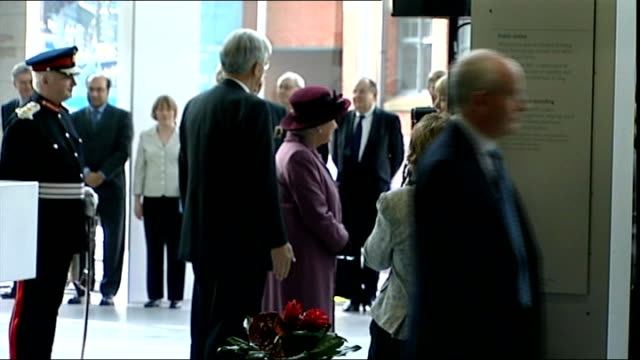 queen and duke of edinburgh visit manchester queen greeting dignatories / queen signing visitors book - signierstunde stock-videos und b-roll-filmmaterial