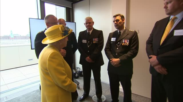 Queen and Duke of Edinburgh visit New Scotland Yard building EXT Queen Elizabeth II looks at view from balcony with Cressida Dick Queen with Mark...