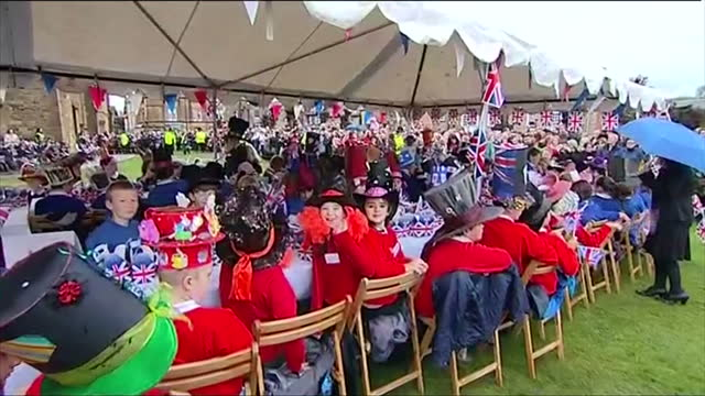 queen and duke of edinburgh visiting sherborne as part of diamond jubilee celebration exterior shots of children dressed up as characters from the... - mad hatter stock videos and b-roll footage