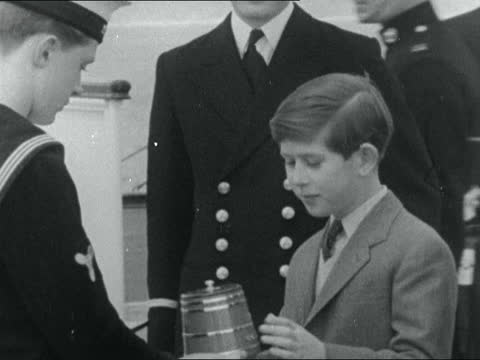 queen and prince charles visit hms eagle; england: dorset: weymouth: ext planes on ship gv queen elizabeth ii and prince charles, prince of wales... - itv evening bulletin stock videos & royalty-free footage