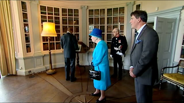 vídeos y material grabado en eventos de stock de queen and prince pembrokeshire visit int interiors of picton castle / queen and prince philip being shown around by guide / interior of castle ext... - pembrokeshire