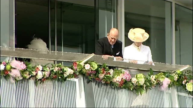 queen and prince philip attend epsom derby england surrey epsom racecourse ext crowds of spectators in stands / prince philip duke of edinburgh and... - princess michael of kent stock videos and b-roll footage