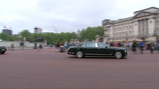 Queen and Prince Philip attend Order of Merit service at St James's Palace Return to Buckingham Palace ENGLAND London Buckingham Palace EXT Motorcade...