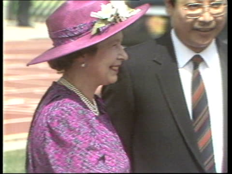 queen and prince philip attend races at sha tin racecourse; car along / queen getting out of car and shaking hands / queen watching people doing... - wheelchair basketball stock videos & royalty-free footage