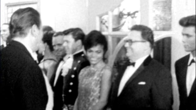 queen and prince philip attend royal variety performance 2012 29419 / tx int queen elizabeth ii shaking hands with harry secombe cliff richard and... - harry secombe stock videos and b-roll footage