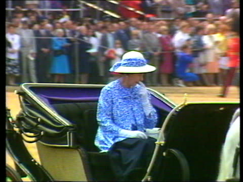 queen and prince philip collection 7 143190 london queen elizabeth ii in blue dress and white and blue hat queen in carriage as troops march in... - dress stock videos & royalty-free footage