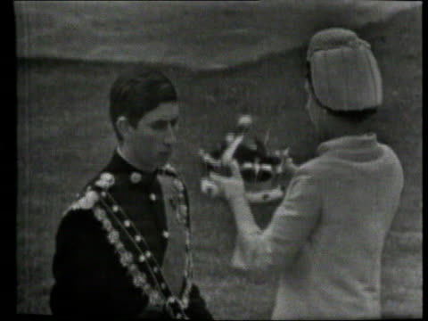 queen and prince philip collection 7; 1.7.69 prince charles investiture as prince of wales wales: caernarvon: queen elizabeth ii places crown on... - チャールズ皇太子点の映像素材/bロール