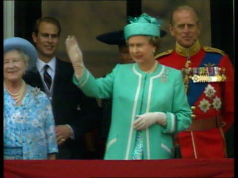 Queen and Prince Philip Collection 7 T16069012 London Queen Elizabeth II in light green suit waving from Buckingham Palace balcony
