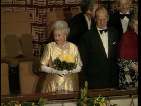vídeos de stock, filmes e b-roll de queen and prince philip collection 7 t19119704 191197 concert held on the eve of the royal couple's golden anniversary london royal festival hall... - característica de construção
