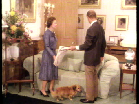 queen and prince philip collection 7; tx 6.2.77;photocall at the start of silver jubilee year scotland: balmoral: prince philip hands paper to the... - königin stock-videos und b-roll-filmmaterial