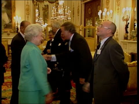 vídeos de stock, filmes e b-roll de queen and prince philip collection 8 r02030511 the queen hosts a reception for the british music industry london buckingham palace the queen meeting... - terry wogan