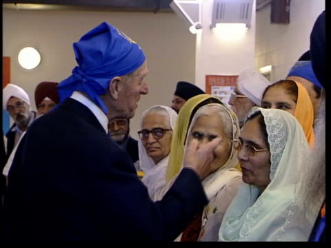 queen and prince philip collection 8 t15100479 1 the queen visits sikh temple in london london hounslow the queen wearing shawl and prince philip... - shawl stock videos and b-roll footage