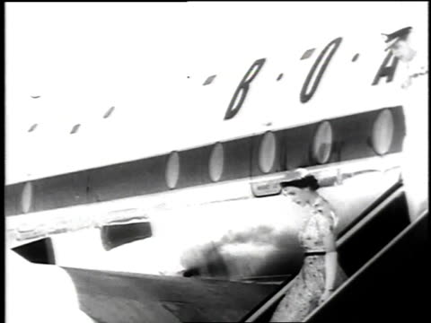 vidéos et rushes de queen and prince philip disembarking from plane in jamaica / greeting british governorgeneral hugh foot / queen and prince reviewing uniformed guard... - 1953