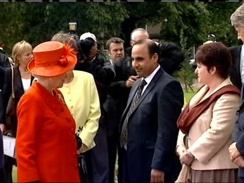 Queen and Prince Philip Dundee University / Baxter Park visit Merrill Smith introducing Queen Elizabeth and Prince Philip at royal lineup to Mohammed...