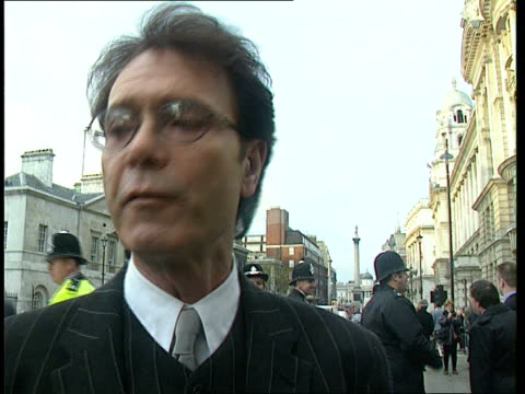 golden wedding anniversary **** for rushes see foot of file england london whitehall ext sir cliff richard embraces singer shirley bassey sir cliff... - see other clips from this shoot 15 stock videos and b-roll footage
